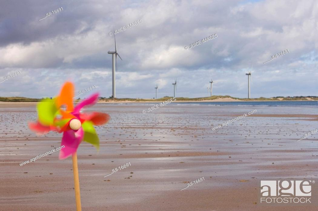 Stock Photo: Windmills and pinwheel on shore.