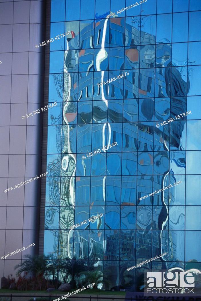 Stock Photo: Reflection on glass of Bandra Kurla Complex , Bombay Mumbai , Maharashtra , India.
