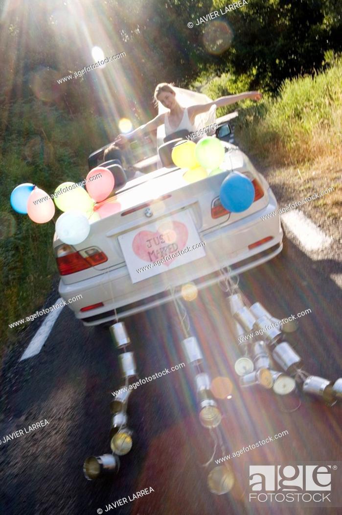 Stock Photo: Just Married. Convertible car with tin cans. Gipuzkoa, Euskadi.