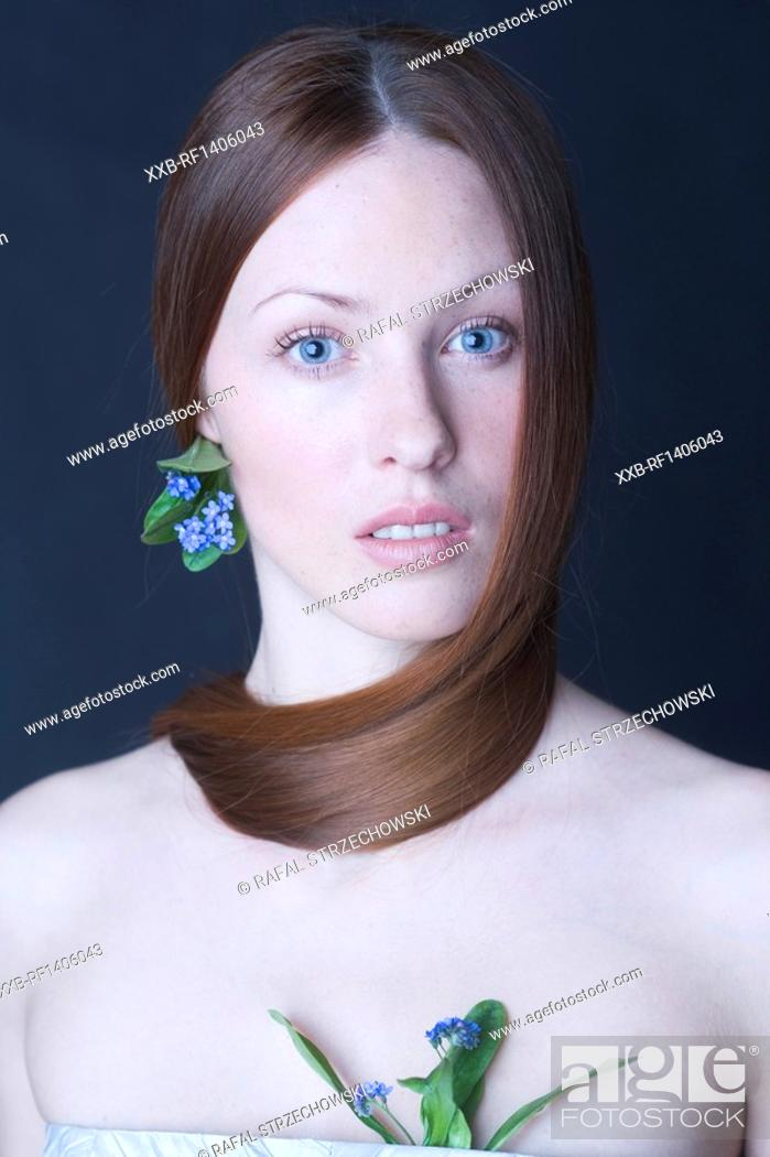 Stock Photo: beauty woman with forget-me-nots.