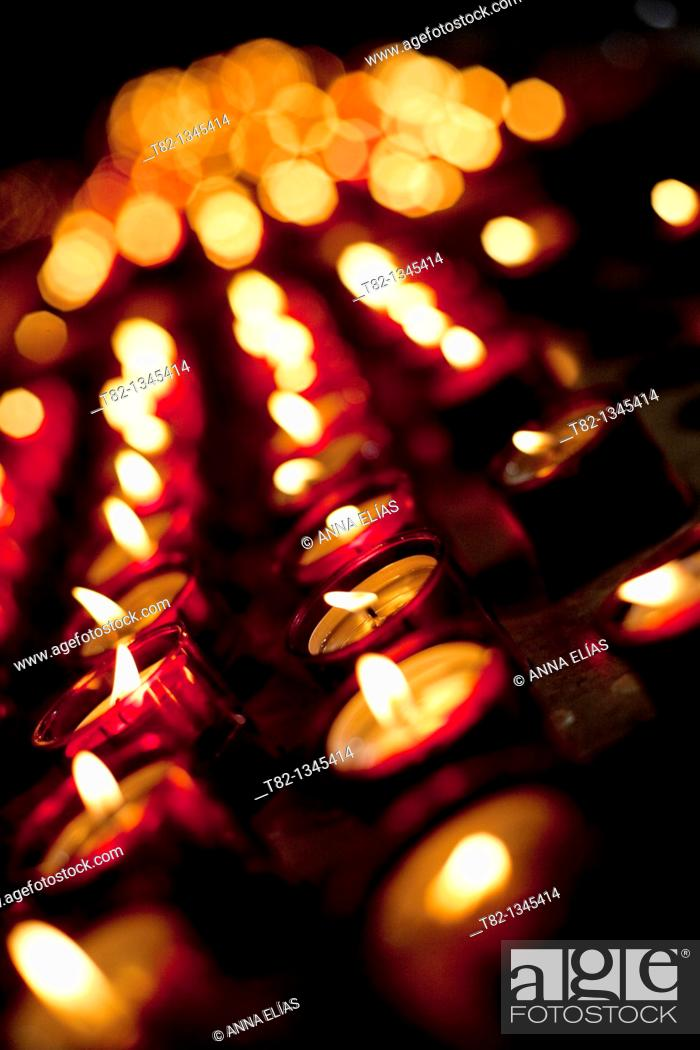 Stock Photo: many candles in church in Lisbon, Portugal.