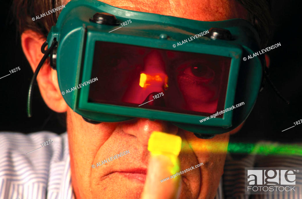 Stock Photo: Scientist developing laser activated holographic memory storage device.