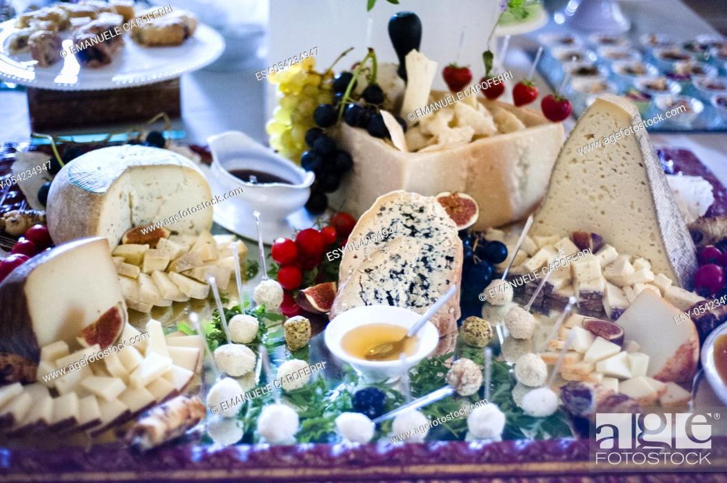 Stock Photo: Table full of cheese for appetizers banquet.