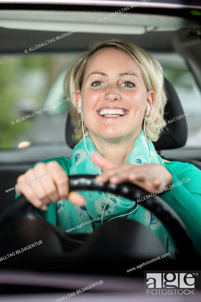 Stock Photo: Female car driver is singing in the car.
