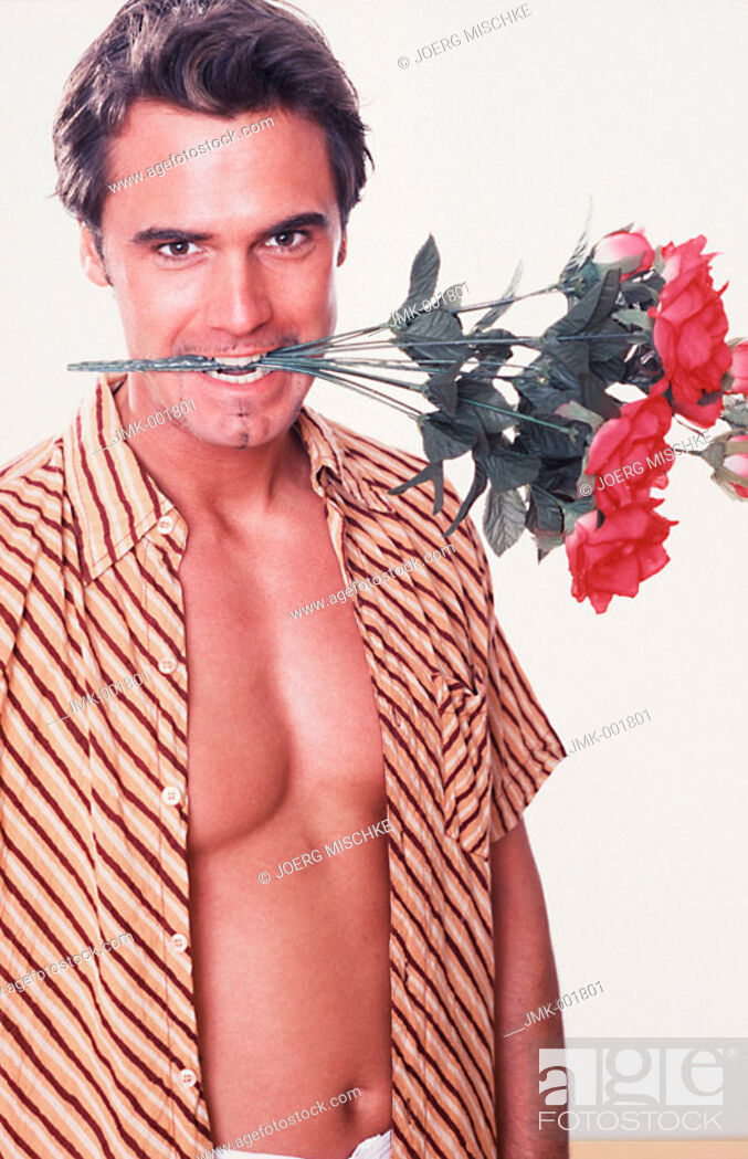 Stock Photo: Portrait of a young man, 20-25 25-30 30-35 years old, dark-haired, masculine and beautiful, holding red roses between the teeth.