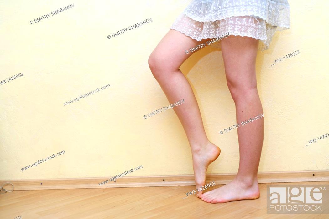 Stock Photo: Caucasian female bare legs indoors.