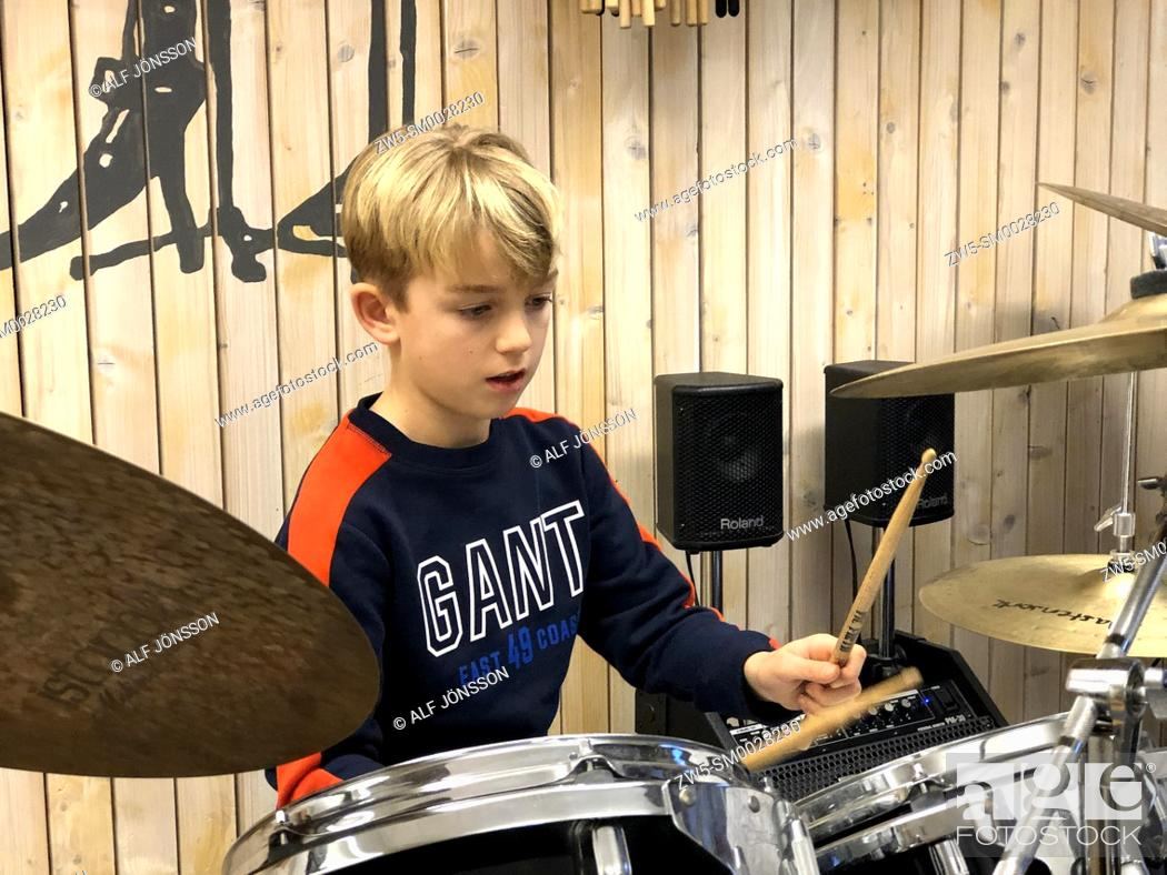 Stock Photo: Boy, 10 years old, in a drumming lesson in Ystad, Sweden.