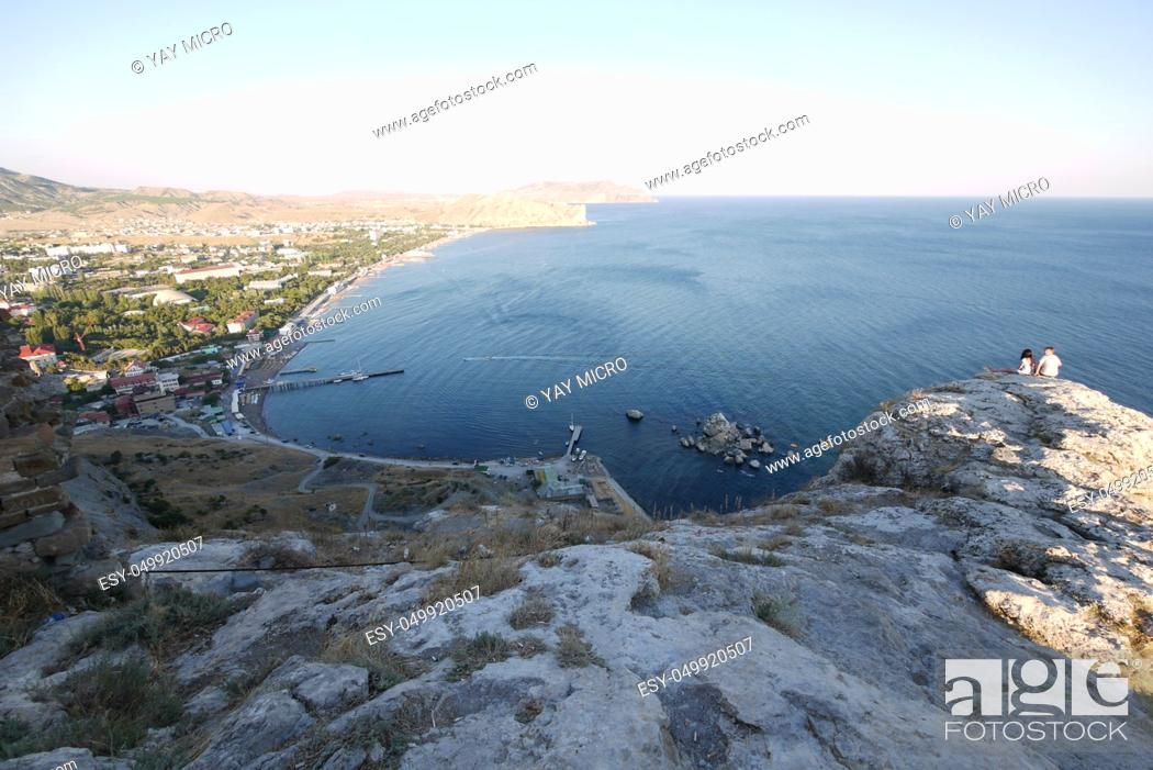Stock Photo: Luxurious view of the bay from the rocky cliffs to the sea with beaches and hotels on the shore with a dock and boats standing next to it.