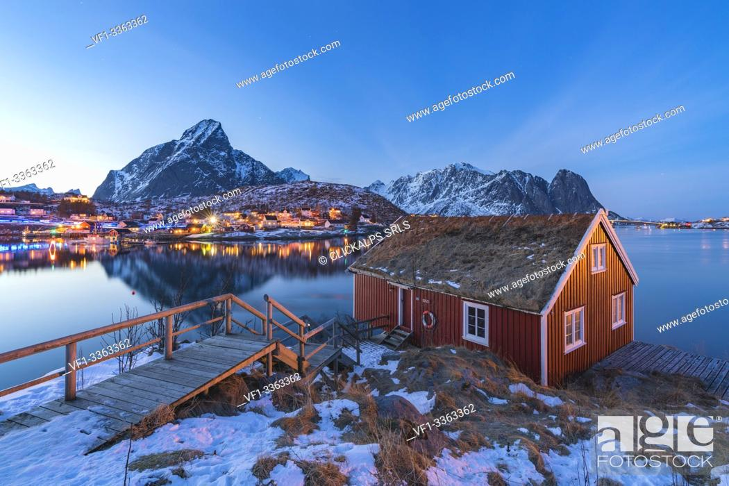 Stock Photo: Traditional fishermen house above Reine Bay at dusk in winter. Reine, Nordland county, Northern Norway, Norway.