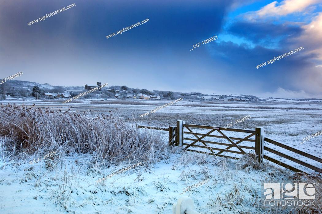 Stock Photo: Salthouse village and grazing marshes Norfolk in Winter snow.