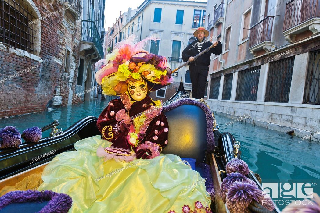 Stock Photo: A masked woman in a gondola at the carnival in Venice, Italy, Europe.