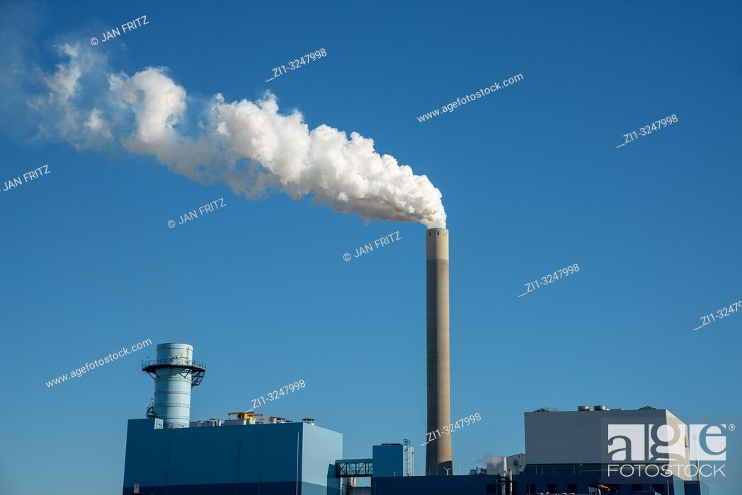 Stock Photo: powerplant with smoking pipe and blue sky.