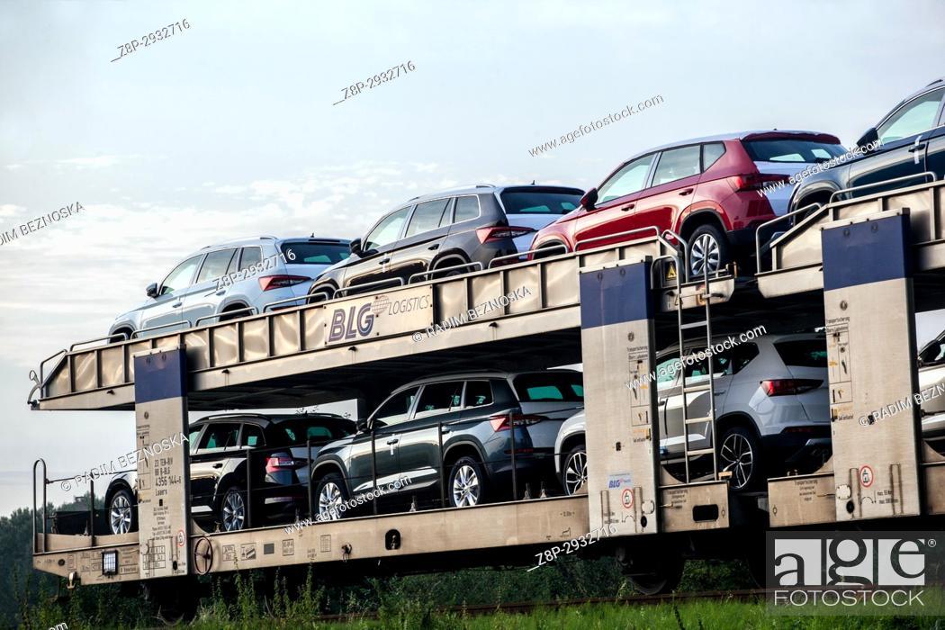 Stock Photo: New Skoda cars on railway wagons produced by Skoda car factory Kvasiny.