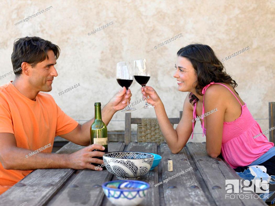 Stock Photo: Couple toasting with wine.