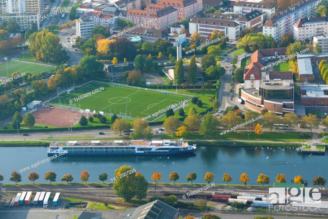 Stock Photo: France, Bas Rhin 67, Strasbourg, Bassin des Remparts, Rhine canal with river cruise boat aerial view.