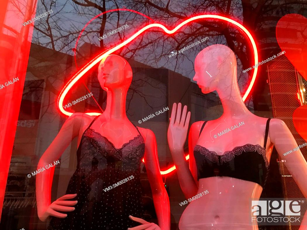 Stock Photo: Two mannequins wearing sexy lingerie in a shop window. Madrid, Spain.