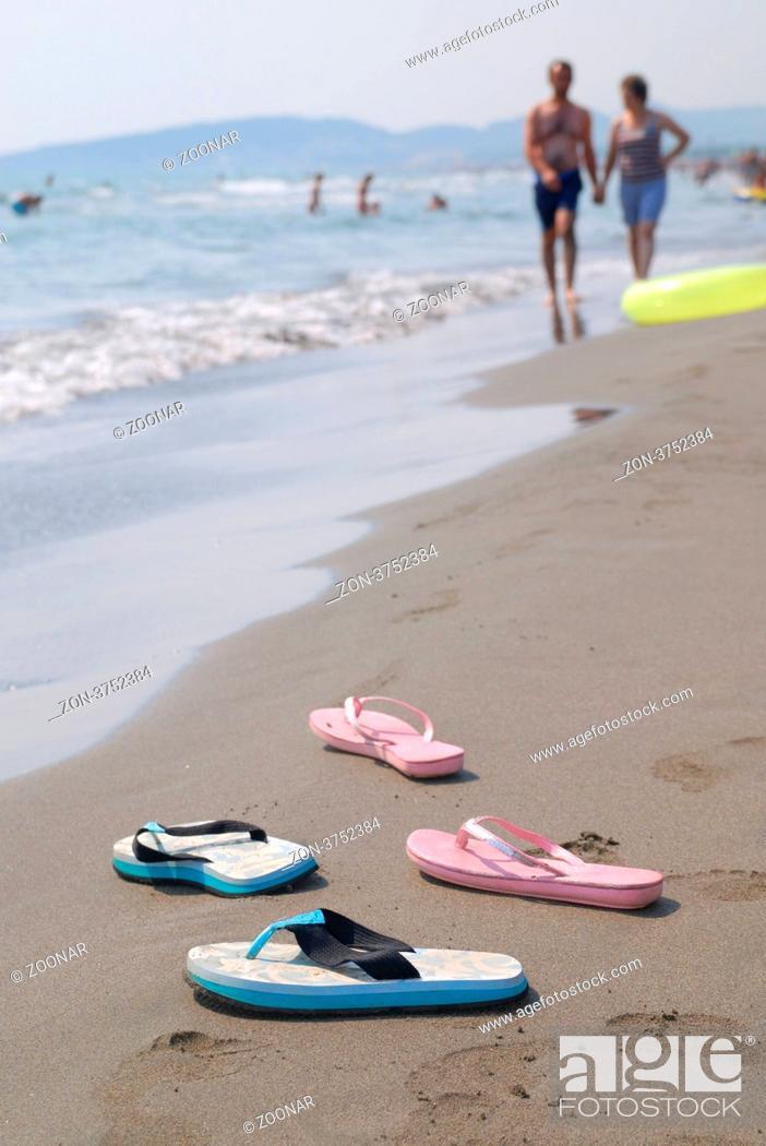 Stock Photo: sandals pair on beach.