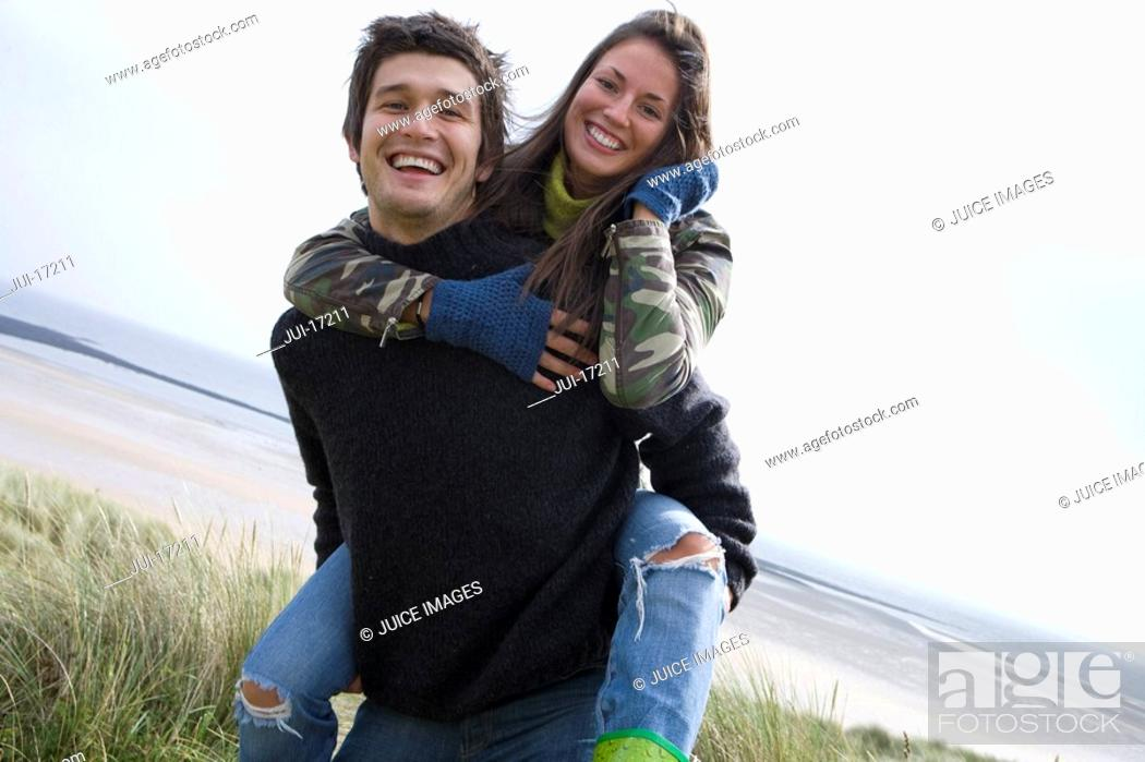 Stock Photo: Portrait of happy young couple at beach.