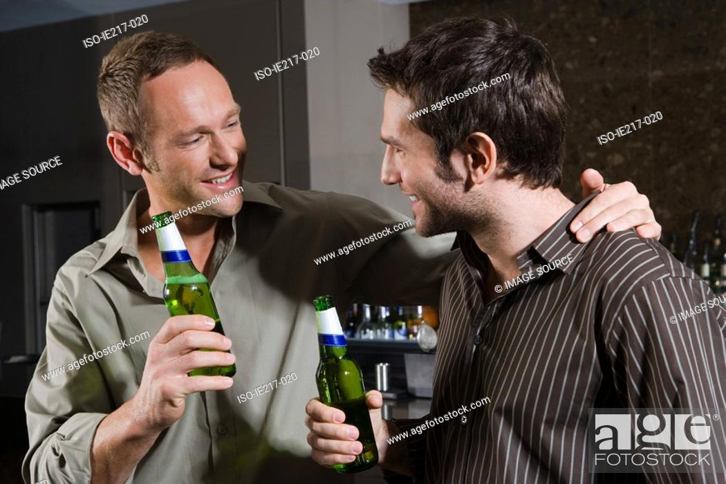 Stock Photo: Two men drinking in a bar.