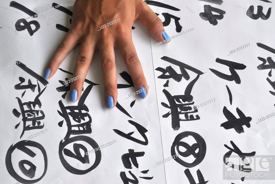 Stock Photo: Itoman, Okinawa, Japan: poster with ideograms during a wedding ceremony at Bibi Beach.