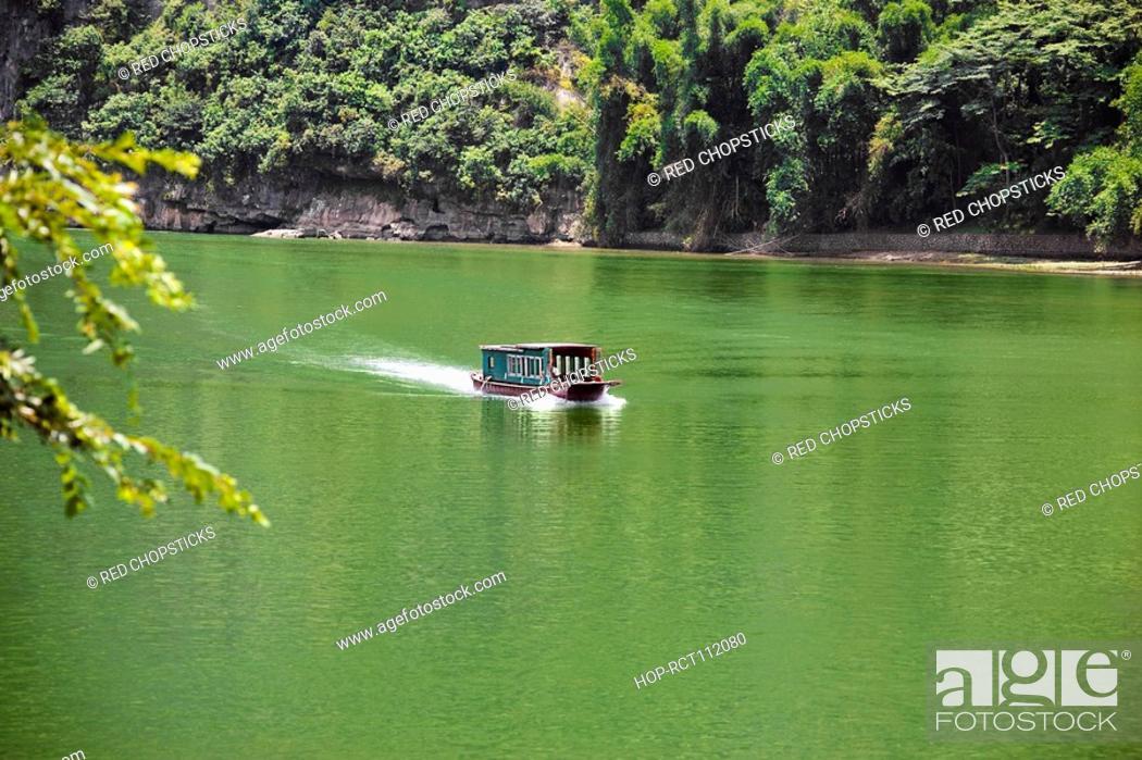 Stock Photo: Boat in a river, XingPing, Yangshuo, Guangxi Province, China.