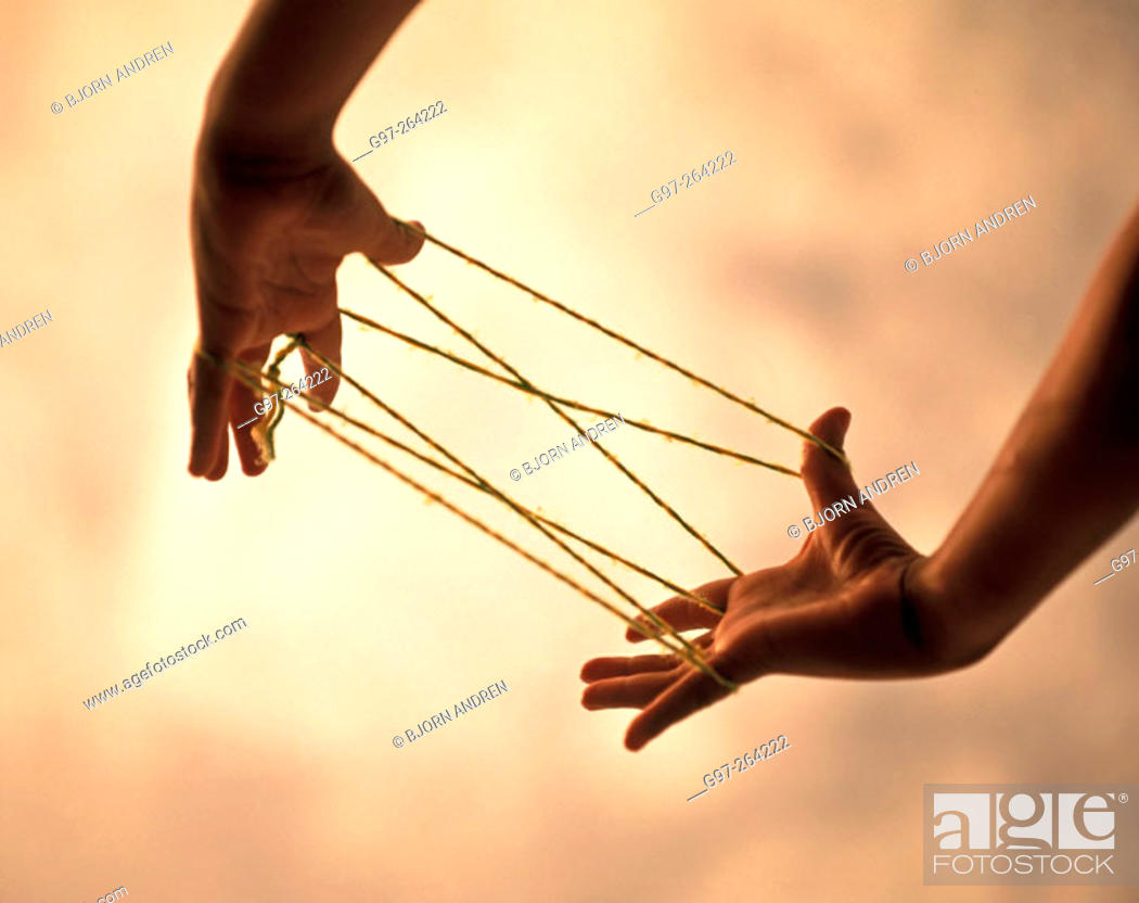 Stock Photo: Hands with strings.