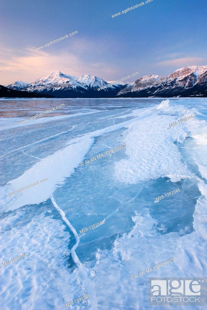 Stock Photo: Daybreak over the wind blasted surface of Abraham Lake, Alberta Canada.