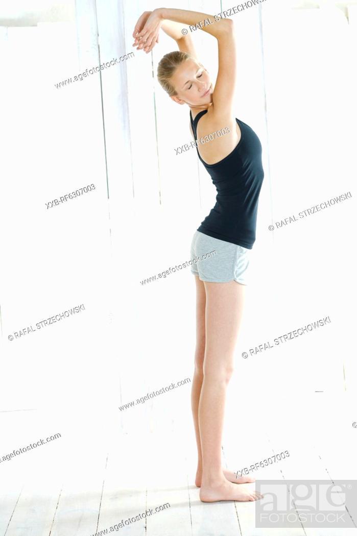 Stock Photo: young woman doing yoga.