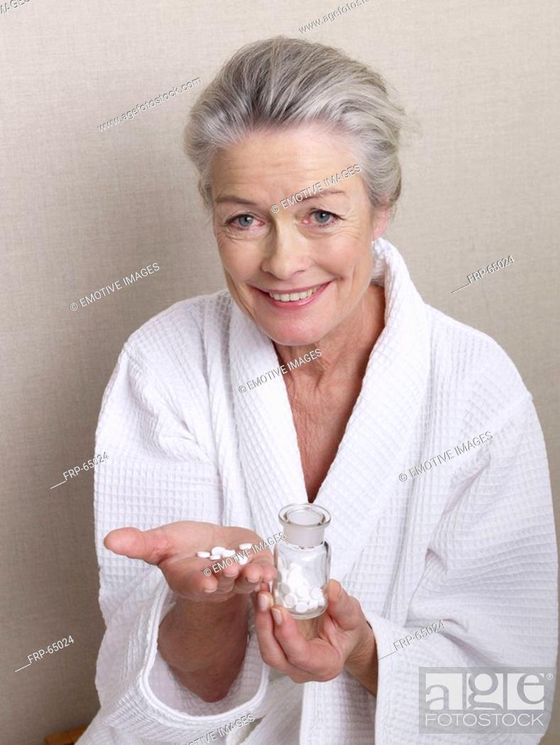 Stock Photo: Senior lady with homeopathic crystal salts.
