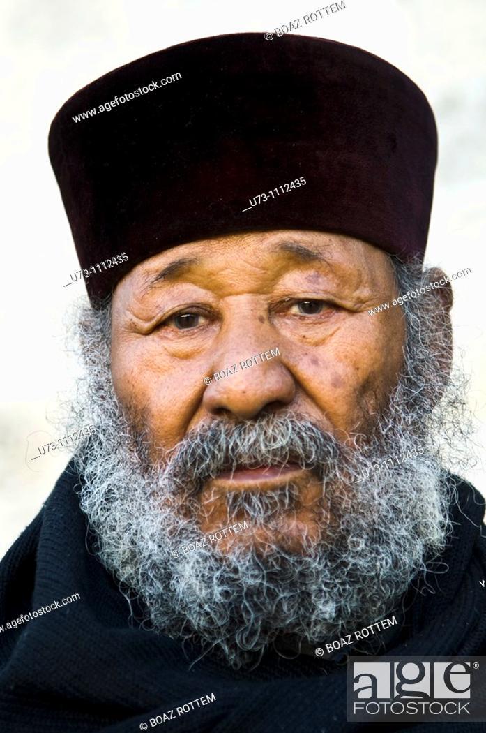 Stock Photo: Portrait of an Ethiopian orthodox priest taken during his pilgrimage in Jerusalem.