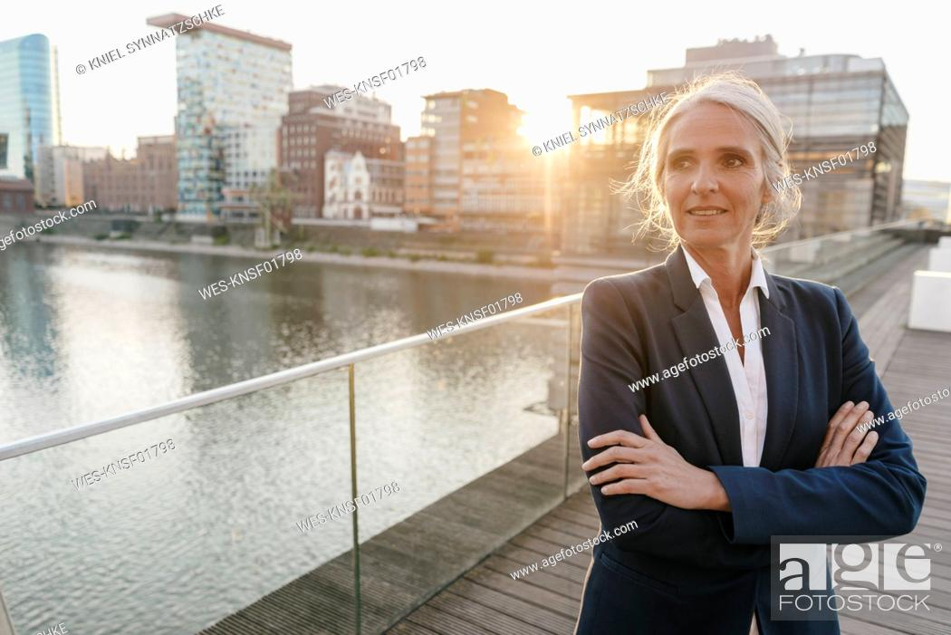 Stock Photo: Confident businesswoman standing on bridge.