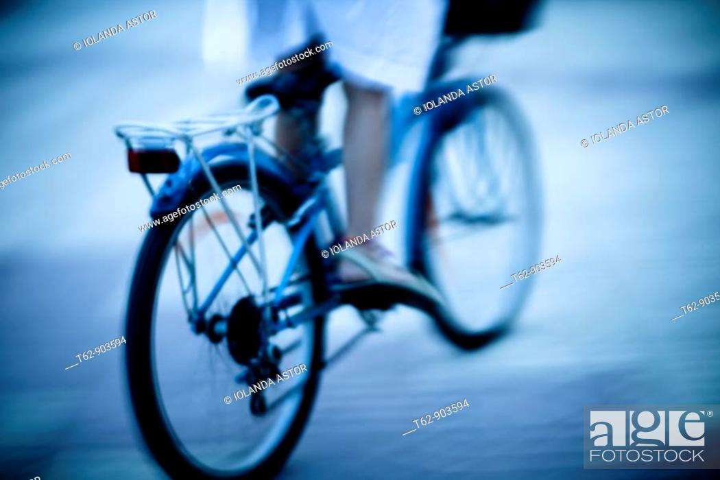 Stock Photo: Teenager on bicycle  Motion and blur.