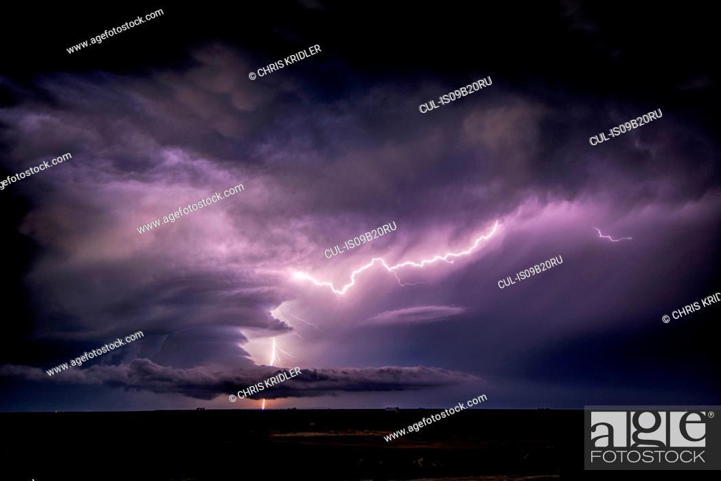 Stock Photo: Lightning sparks from a spinning supercell thunderstorm at night near Leoti, Kansas.