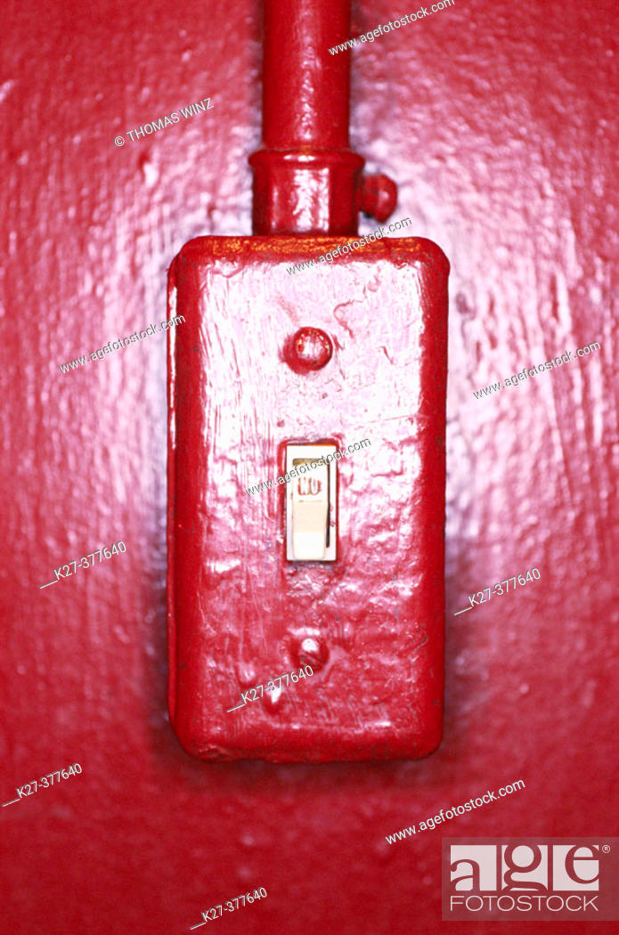 Stock Photo: Light switch on red wall.