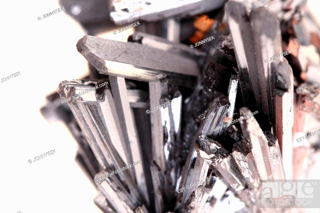 Stock Photo: metal stibnite mineral isolated on the white background.