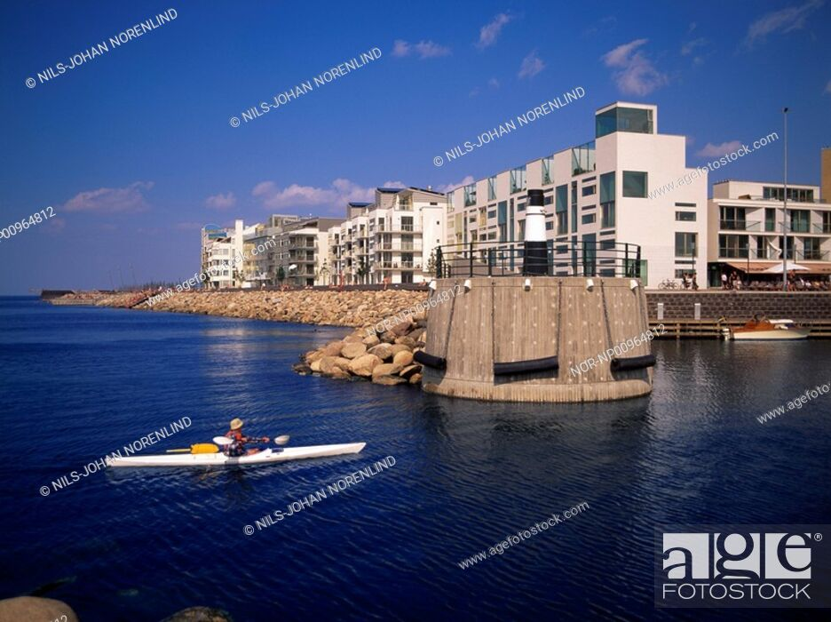 Stock Photo: A person sailing canoe in the sea.