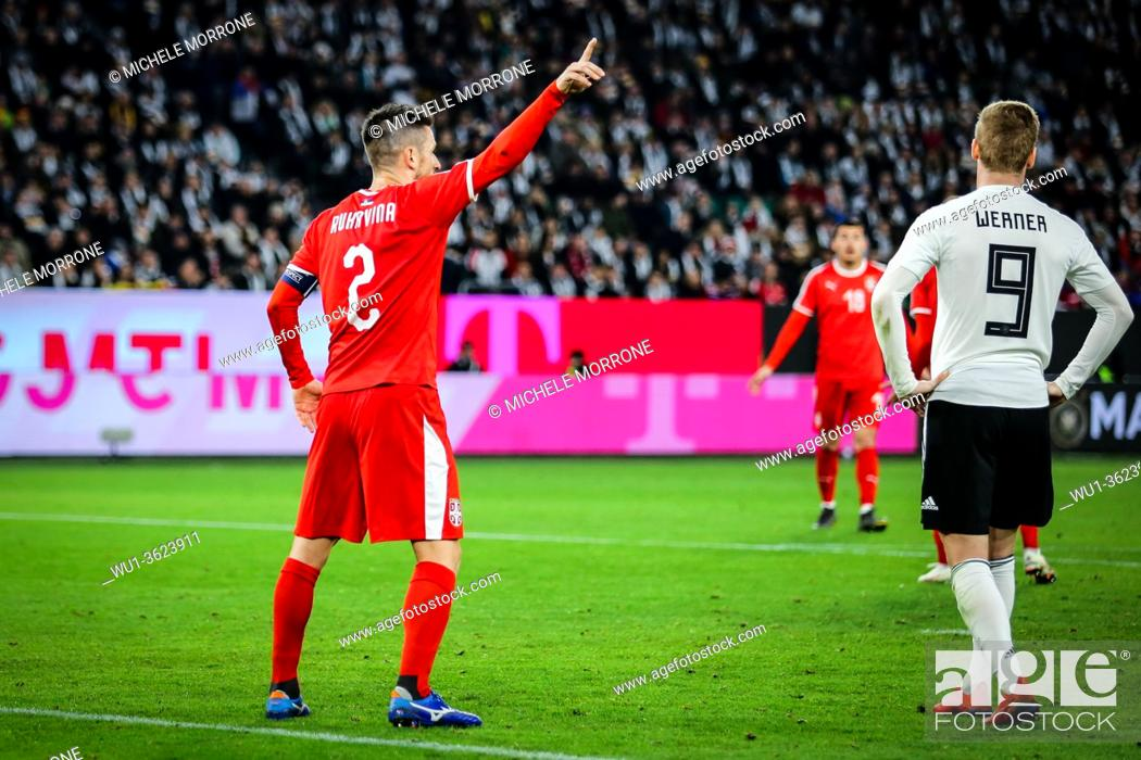 Imagen: Wolfsburg, Germany, March 20, 2019: Serbian national team captain Antonio Rukavina directs his teammates during the international friendly game Germany vs.