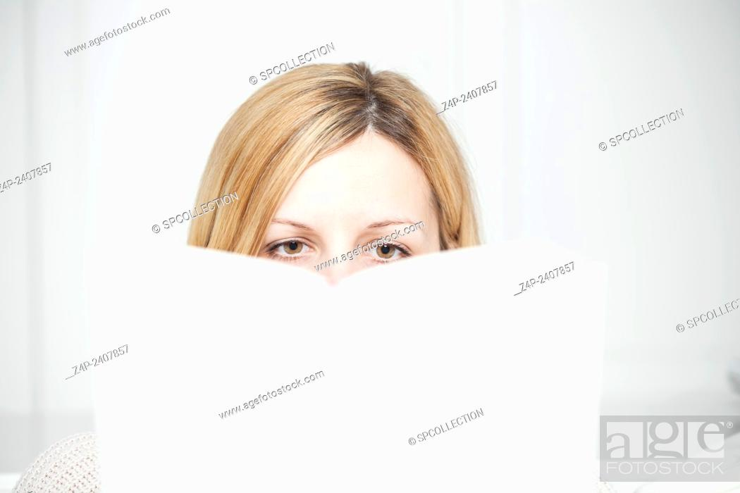 Stock Photo: woman attentively reads a book.