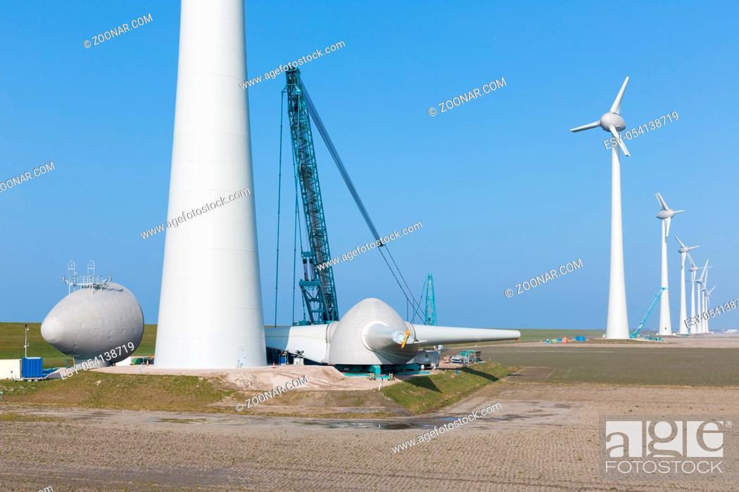 Photo de stock: Dutch farmland with construction site new wind turbine farm.