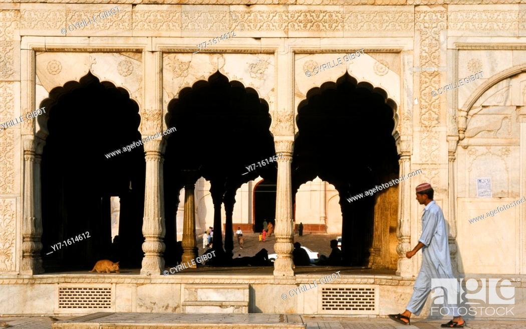 Stock Photo: Man walking by marble pavilion in Lahore, Pakistan.