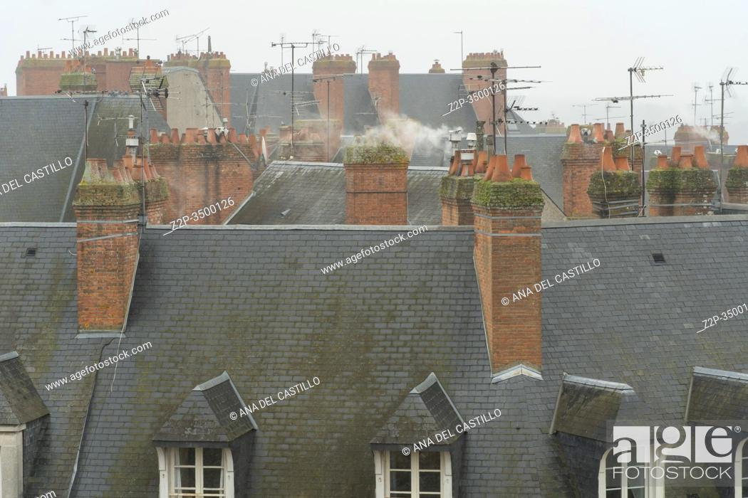 Stock Photo: Chimneys and roofs of the medieval town Blois in Loire valley , France.