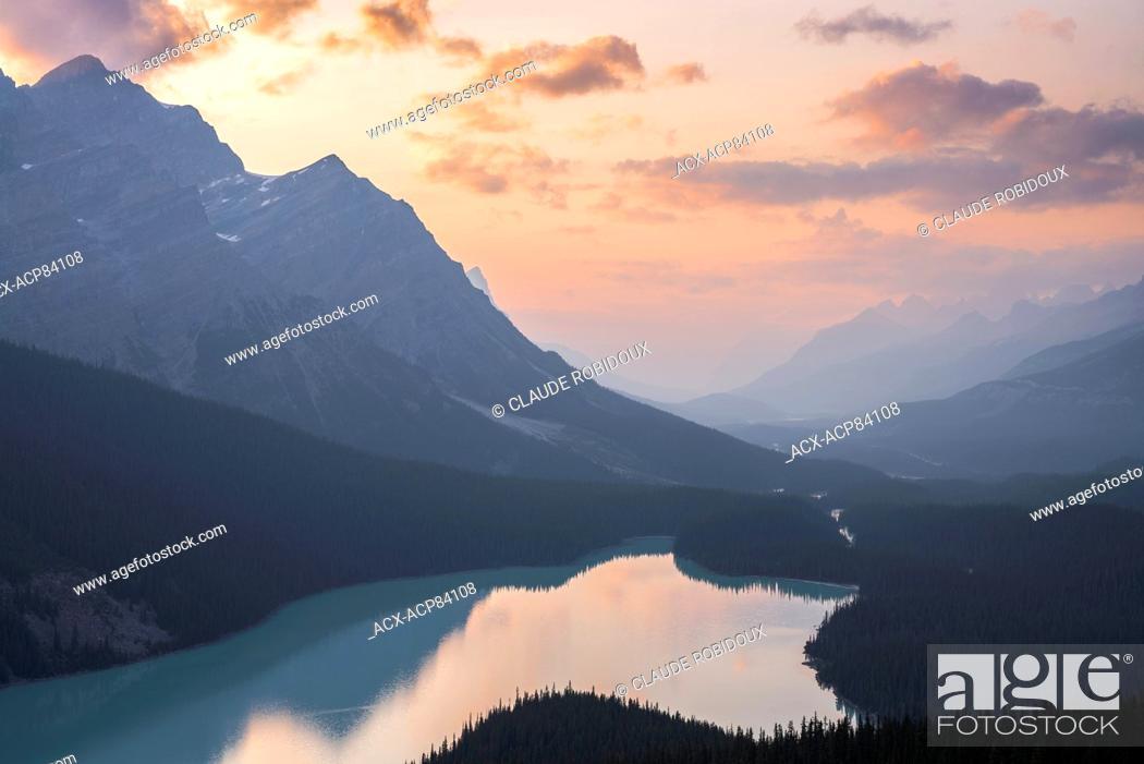 Stock Photo: Colourful sky at dusk above Peyto Lake. Banff National Park, Alberta, Canada.