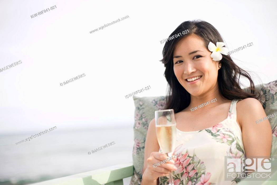 Stock Photo: A woman holding wineglass.