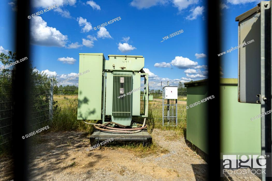 Stock Photo: Hambach, Germany. The Hambach Brown Coal Open Pit Mine fuelles an Electrical Power Plant, but is considered to exhaust to much carbon and CO2.