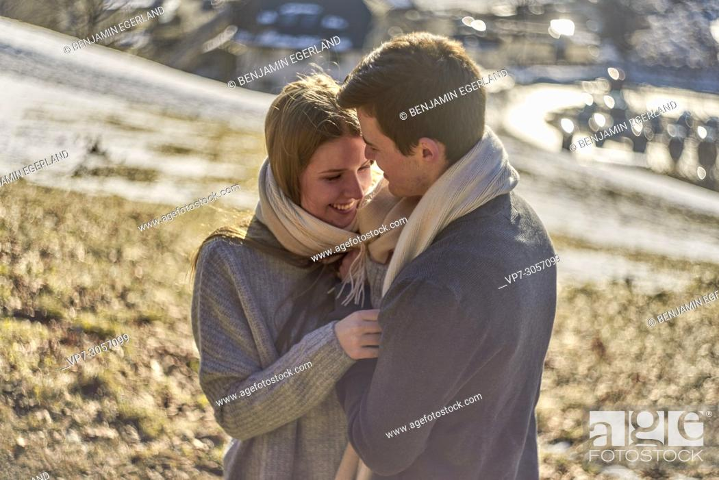 Imagen: Tegernsee, Germany, couple in winter with scarf, sunny weather.
