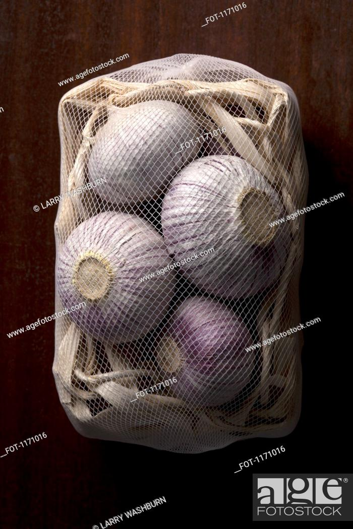 Stock Photo: A net bag of onions.