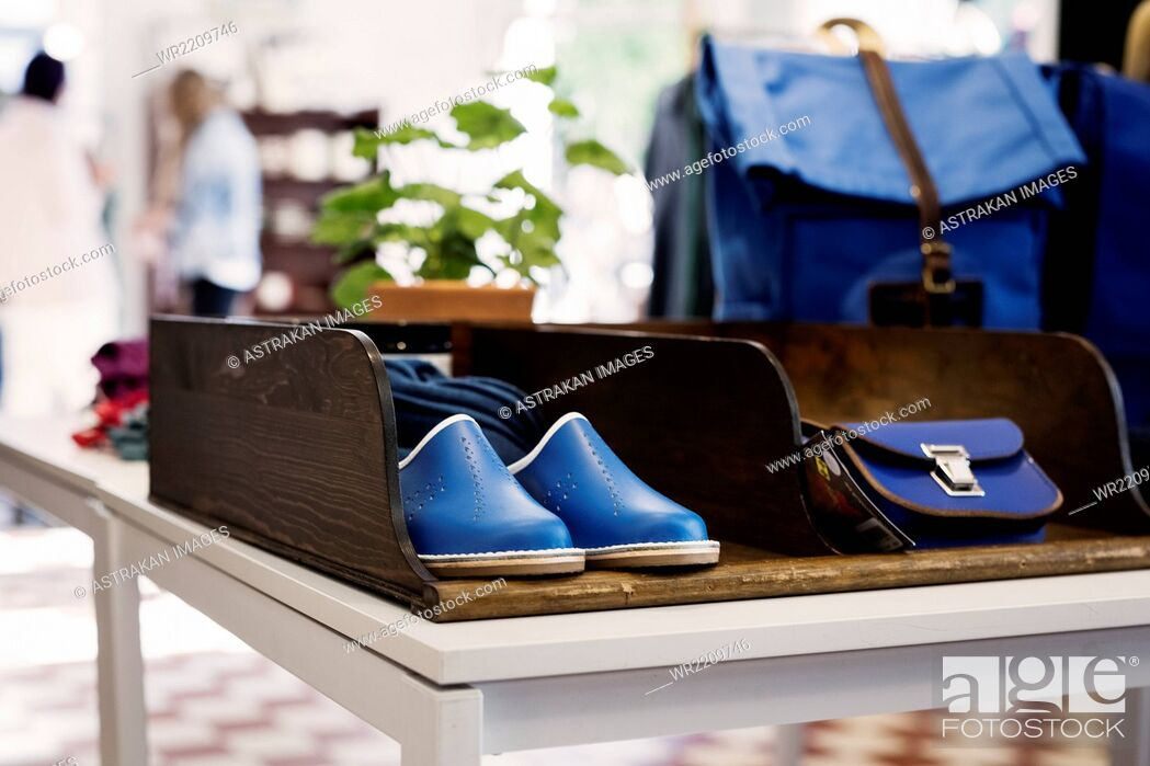 Stock Photo: Shoes and bags displayed at store.