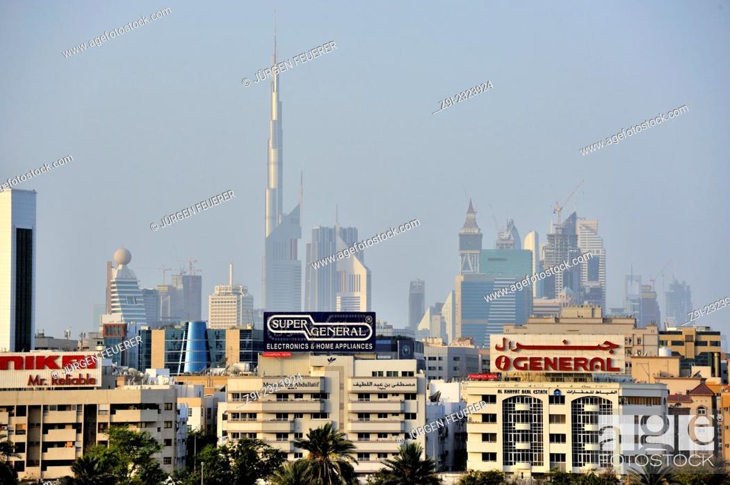 Stock Photo: View from Dubai Creek chanel to downtown Dubai with skyscrapers and Burj Khalifa, Dubai, United Arab Emirates.