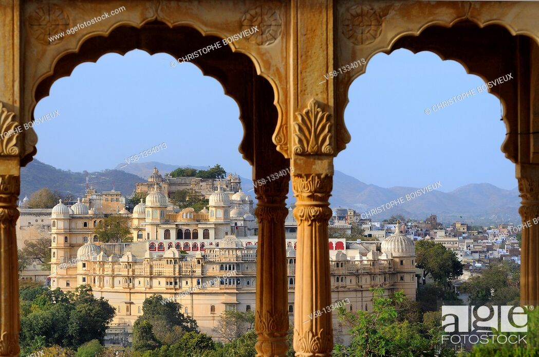 Stock Photo: India, Rajasthan, Udaipur, The City Palace seen from Sunset point.