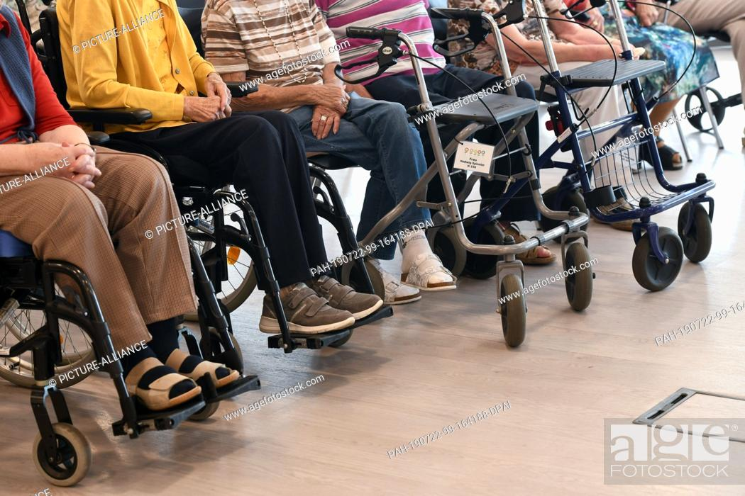 Stock Photo: 22 July 2019, Hessen, Bad Arolsen: Residents of the Helenenheim Bad Arolsen are waiting for the demonstration of the digital game console.